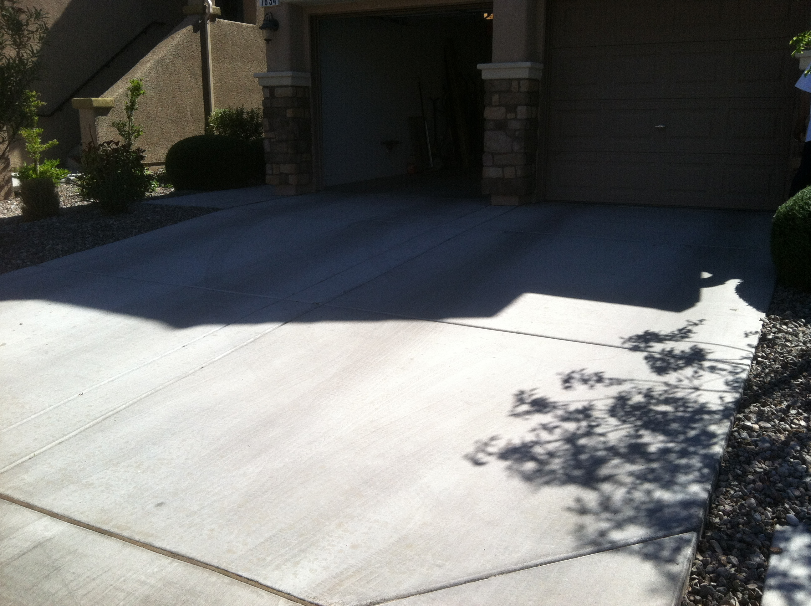 Agonizing over asphalt oil stains drivewaysteamcleaning for Remove stains from concrete driveway